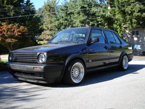 Volkswagen Jetta, snorder, zwarte taxi